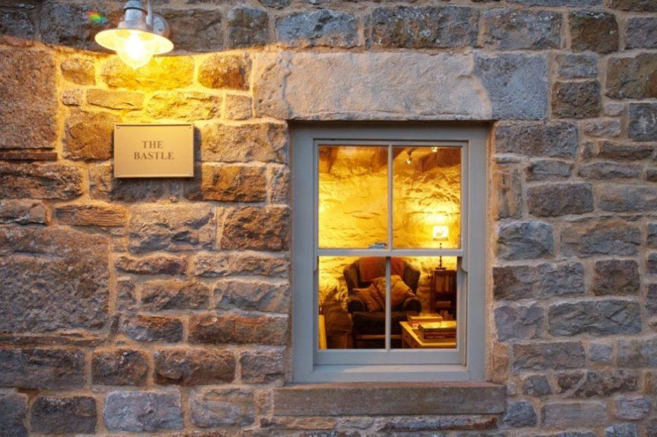Tudor stone bastle Northumberland England Photo by David Webb Bastle sign Stone cottage