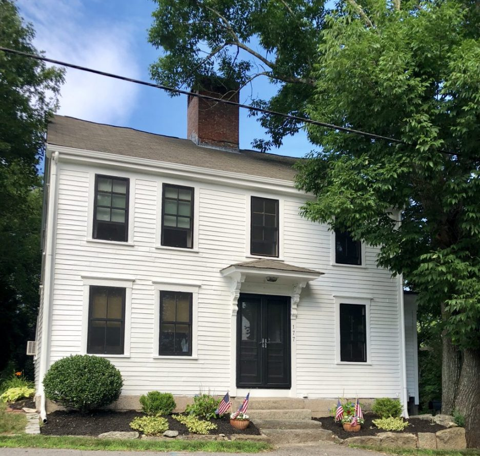 White House black trim black doors littel American flags Kingston MA