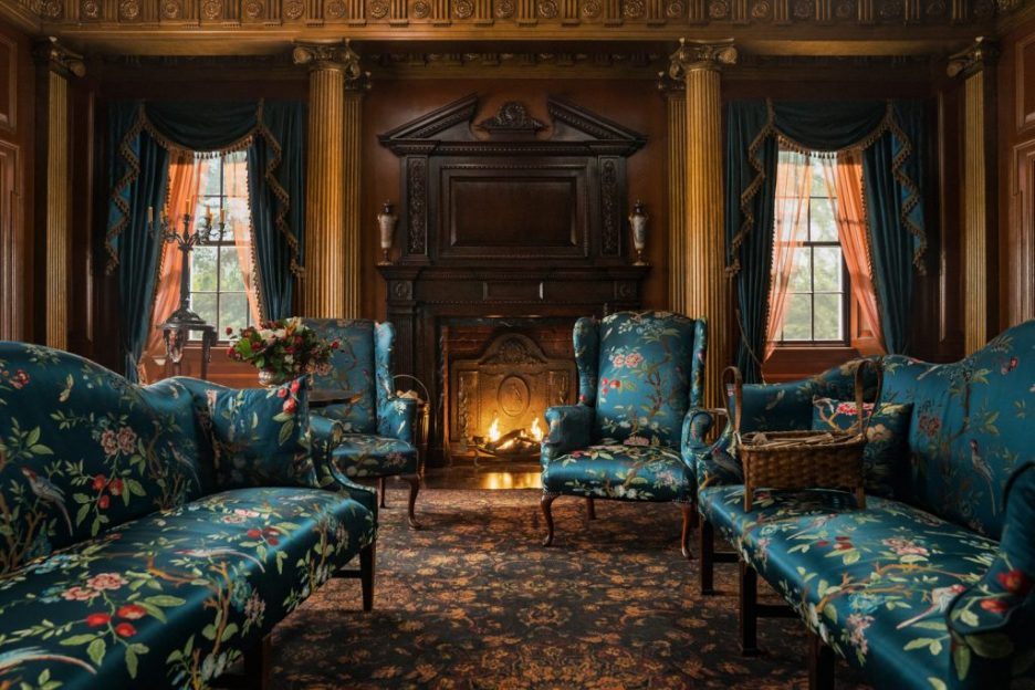 Starz Outlander River Run Parlor settees fireplace