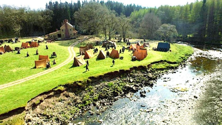 Starz Outlander The Rdige Season 5 external tents and big house on river Outlander-online