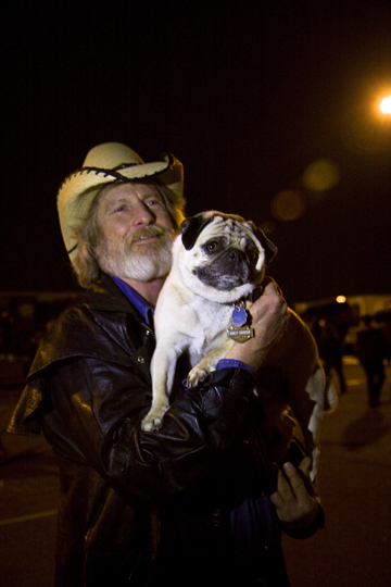 "An ""outlaw"" trucker we met one night with his dog. Since then, our friend has passed."