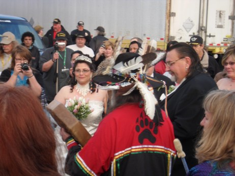 This is a wedding at a truck parking lot at MATS, the largest truck show in North America.