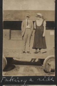 Couple on cart at RR Depot