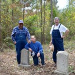 Headstones uncovered by Darrel Barrett, Sam Higdon, and James Penny (left to other) and other members of the clean-up crew at Old Macedonia Cememtery.
