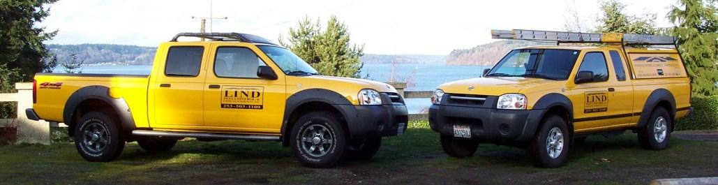Lind Pest Control yellow service trucks