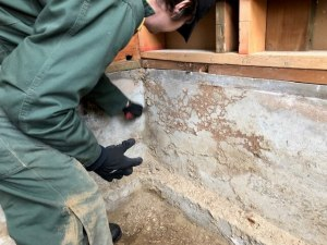 Scraping to make certain all of the subterranean termite tubing is removed. (thoroughness throughout the process is of the utmost importance!