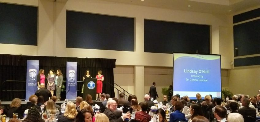 Up on stage with Dean Kirtman of the College of Education and Dr. Gautreau at Honor an Educator dinner!