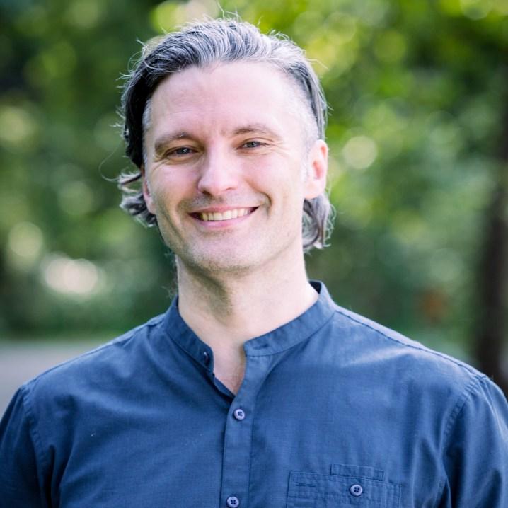daniel foor wearing a button-up blue shirt