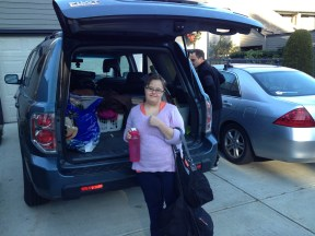 Christie packing her things to go to her new home.