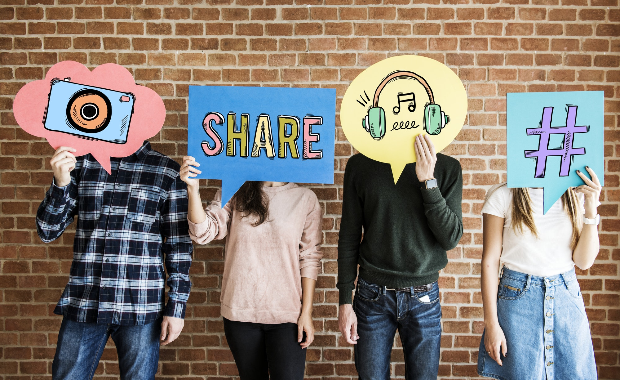 Friends holding up thought bubbles with social media concept ico