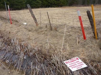 High Pressure Test found on Right of Way. (NOTE: ROW shared with TransCanada gas line. Unable to determine which pipeline was being tested.)