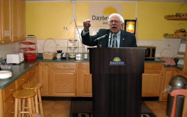 """It is not radical to say that cereal should not come from a glass cylinder, with a little crank on the bottom. Cereal should come from a box."" Sen. Sanders speaks with supporters Wednesday. (AP Photo)"