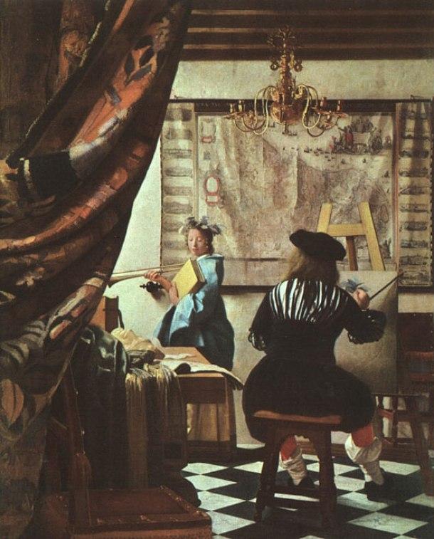 """""""Alegoría de la pintura"""", 1662-1665. Como si hubiese deseado acrecentar su misterio intencionadamente, Vermeer gustaba de retratarse de espaldas."""