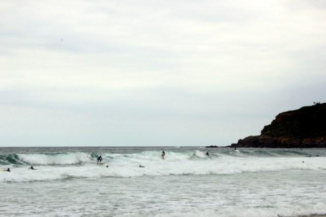 Surfing at Zurriola beach