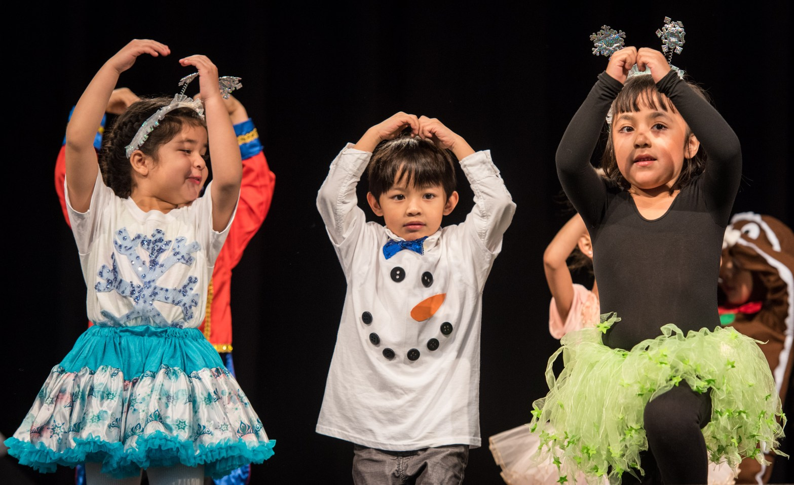 Image of children performing a dance at the 2017 Early Childhood Winter Conference; courtesy of HCDE Staff.