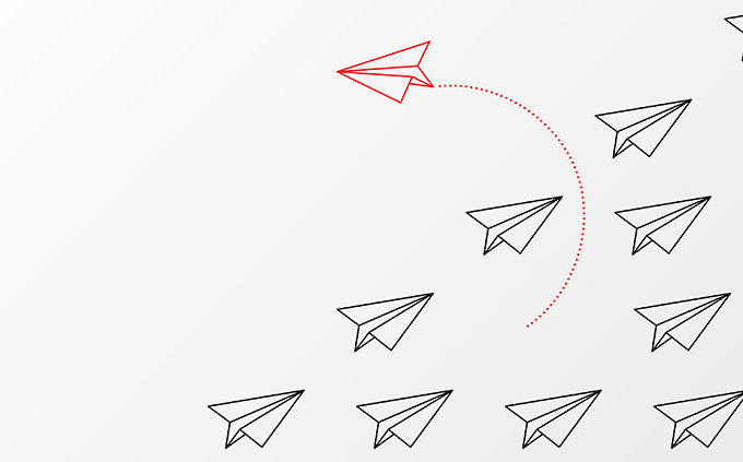 Think differently concept. Red airplane changing direction