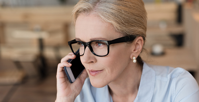woman in eyeglasses with smartphone