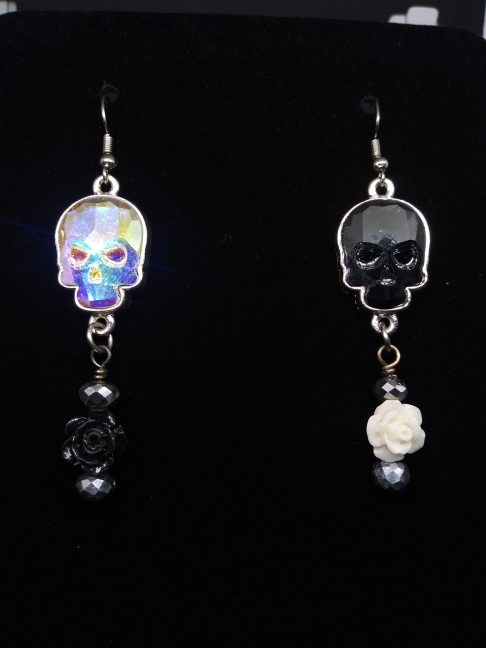 Ying and Yang inspired Swarovski skull earrings with rose embellishments