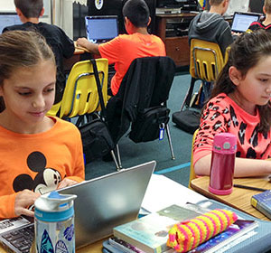 Students on chromebooks - Signature Programs