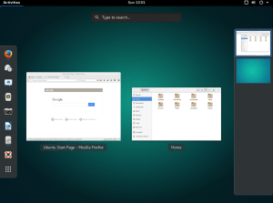 The Activities/Apps Display, showing the current running Apps as well as the Dock and the virtual desktop view.