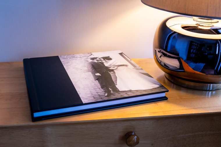 photo story book wedding album on table with lamp
