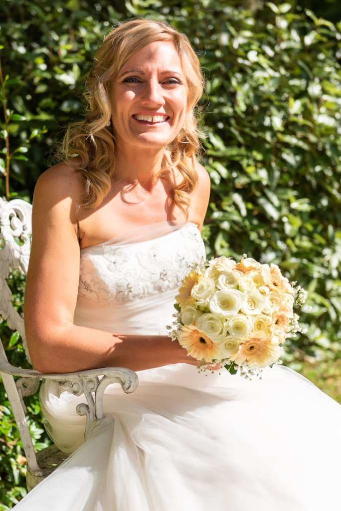 bride portrait seated with bouquet