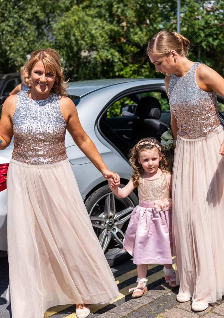 bridesmaids and flower girl arrive at wedding venue