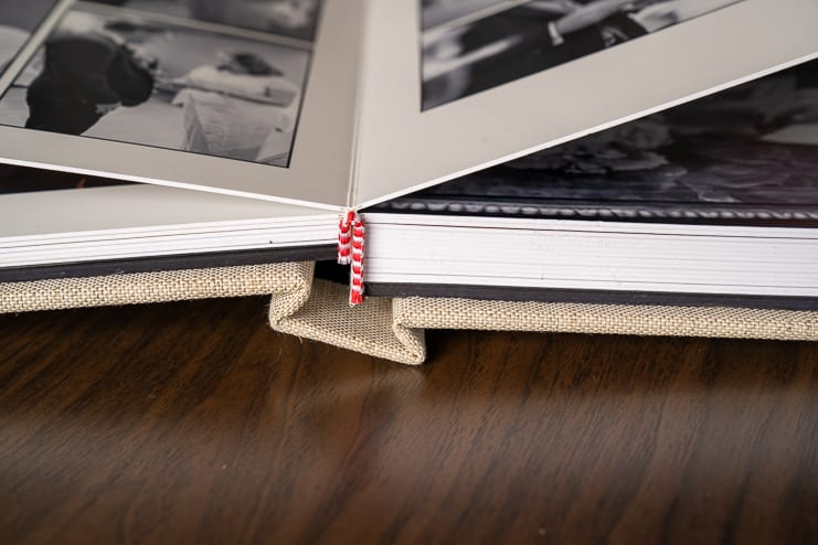 close-up of wedding album binding pages open