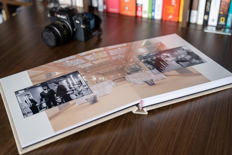 wedding photo story book open at venue pages
