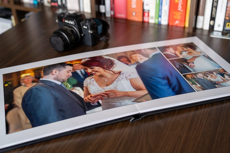wedding album open at wedding ceremony pages