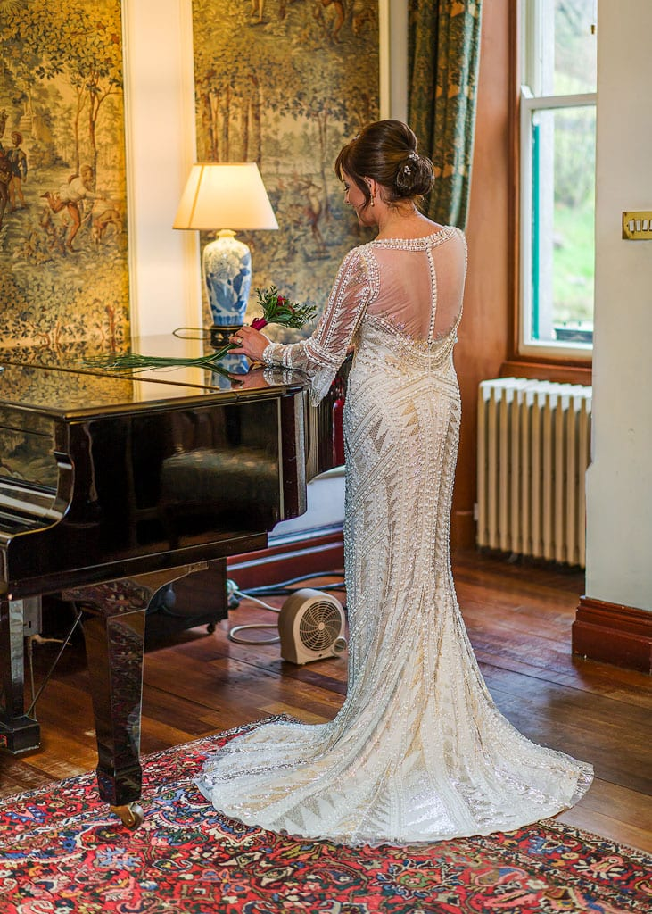 portrait showing the back of the brides dress