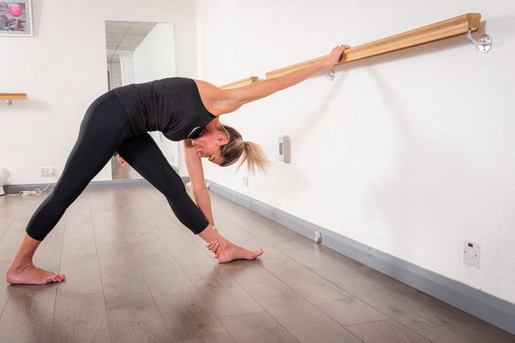 a pilates student demonstrates a pose