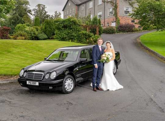 bride and groom with limousine at edenmore