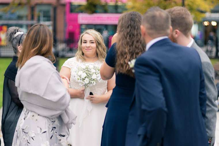 candid bride portrait in city hall grounds