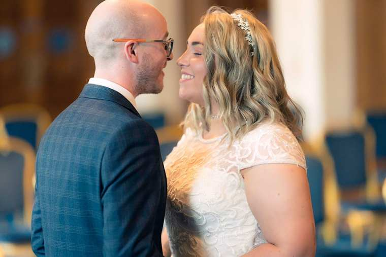 bride and groom first kiss following wedding ceremony