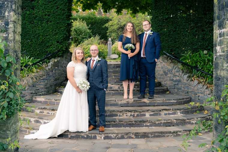 contemporary bridal party group portrait on steps at botanic gardens belfast