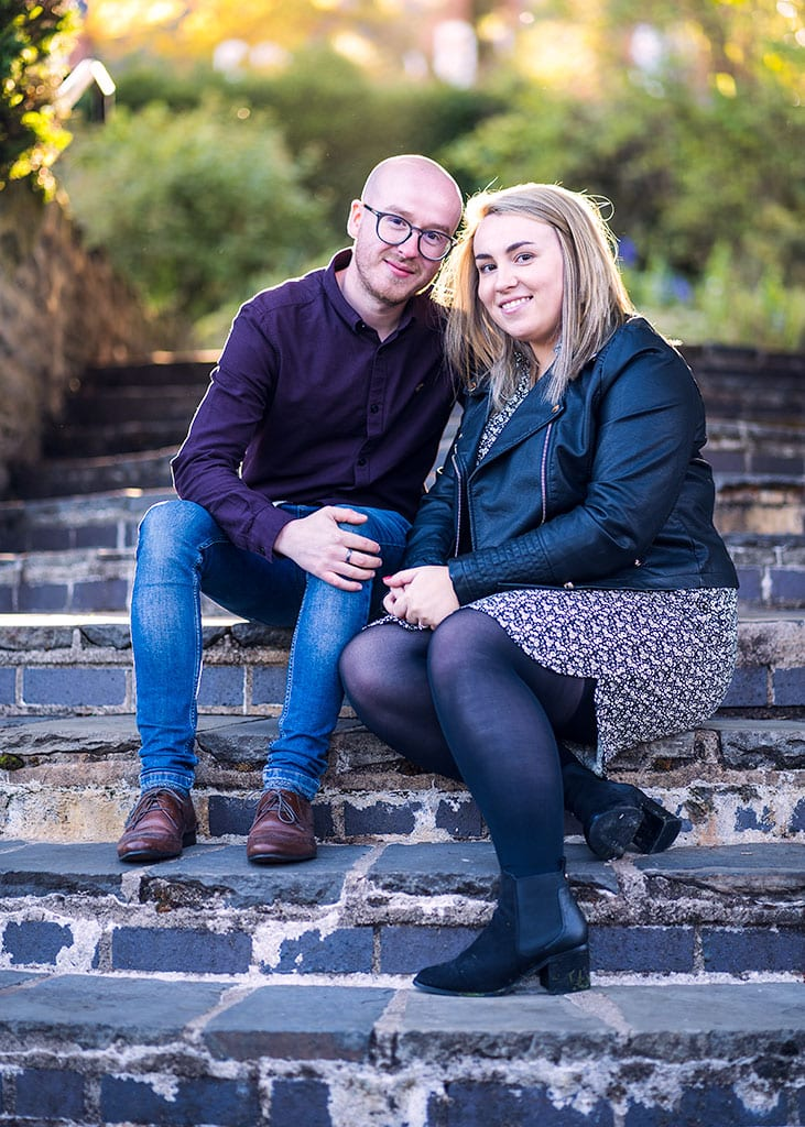 engagement photography couple seated on steps