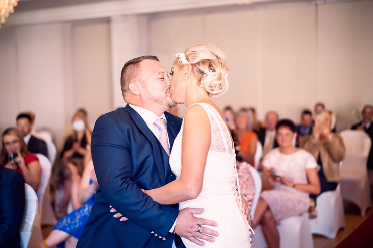 the bride and groom share their first kiss as man and wife