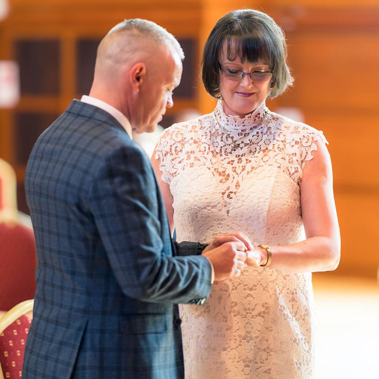 exchange of wedding rings at lisburn civic centre ceremony