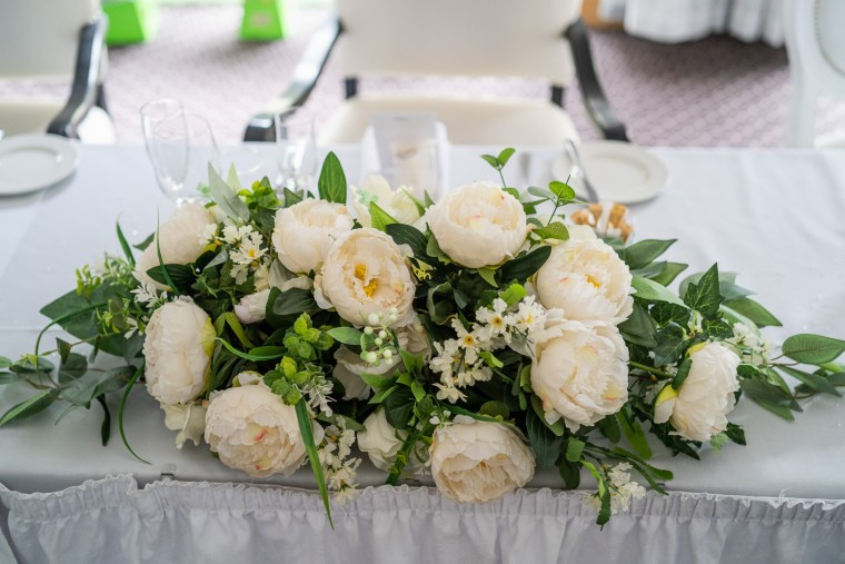 wedding reception details top table flowers