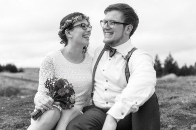 bride and groom laughing at their jokes black and white