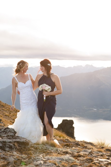queenstown bridesmaid and bride smiling and laughing