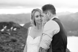 beautiful bride holding onto the groom face