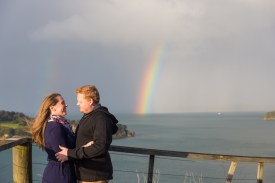 auckland couple in front of a rainbow