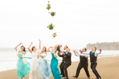 bridal party throwing flower bouquet
