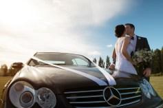 auckland wedding couple kissing against a car