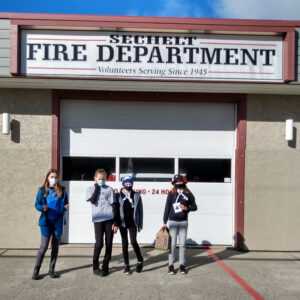 2nd Sechelt Guides donating cookies to local fire department