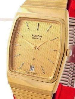 Ricoh flache Quarz Herrenuhr Farbe gold Datum rare vintage mens watch 70152002