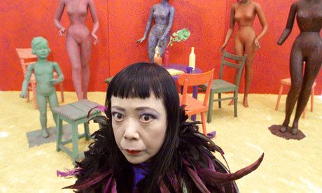 Japanese artist Yayoi Kusama at the Serpentine Gallery with her work The Driving Image. Photograph: Graham Turner