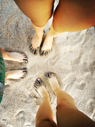 Out feet blackened from the beach stroll